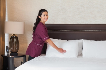 Happy hotel maid - Work in hotel room